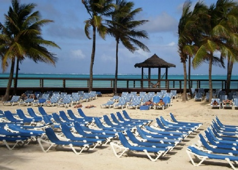 One of the many Caribbean Beaches Furnished with Beach Lounge Chairs.
